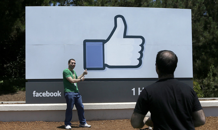Facebook stock slides even as 2Q results soar