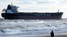 Cargo ship runs aground in windy Chesapeake Bay