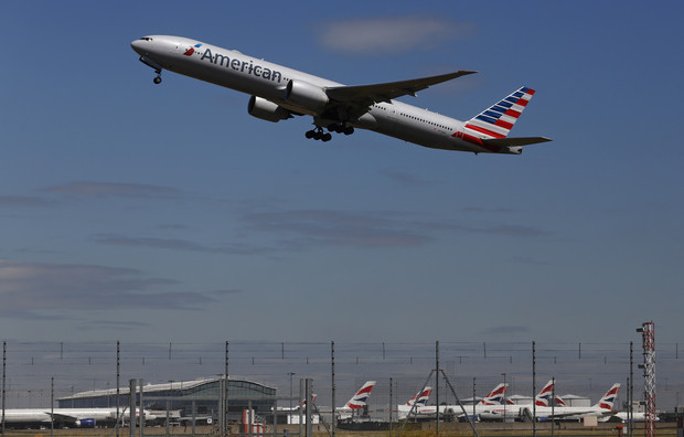 American Airlines declares first dividend since 1980 as profit rises