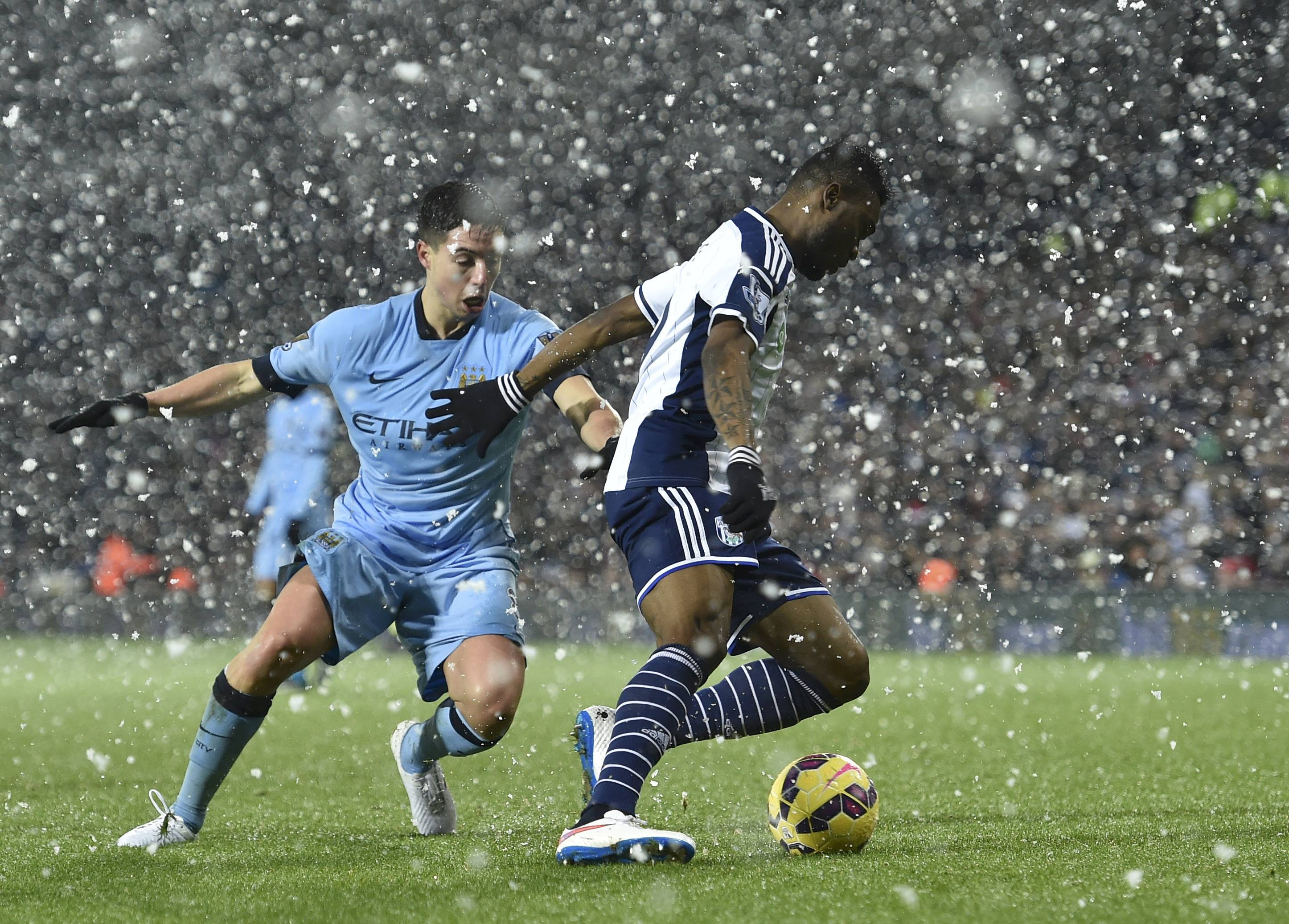 Manchester City's Samir Nasri challenges West Bromwich Albion's Brown Ideye during the English Premier League soccer match at The Hawthorns in West Bromwich