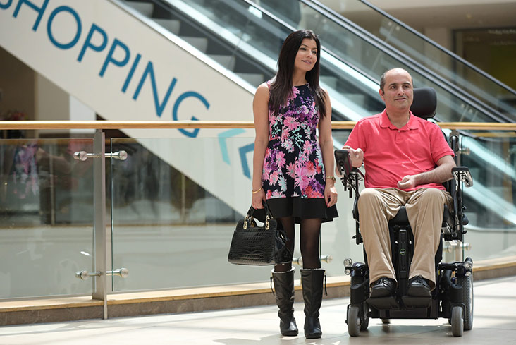 Powered wheelchair user shoppping