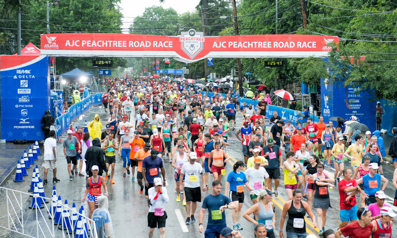 Run the city's mainstay 10k, the Peachtree Road Race. (📷 Gene Phillips, AtlantaPhotos.com)