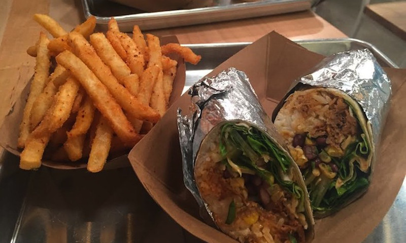 Try a spicy pork burrito and fries at Yumbii. (Malika Bowling)