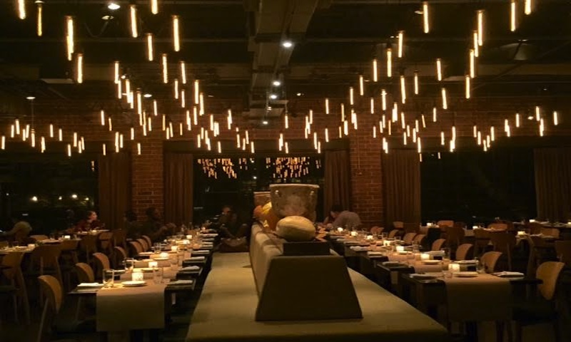 Dining under the magical lights at ONE Midtown Kitchen is a super choice for a rehearsal dinner.