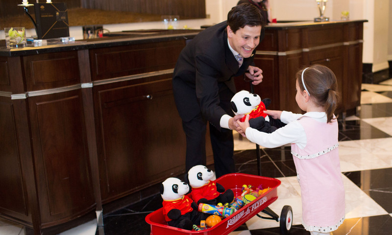 Pint-sized guests at Mandarin Oriental Atlanta get welcomed with smiles and a toy.