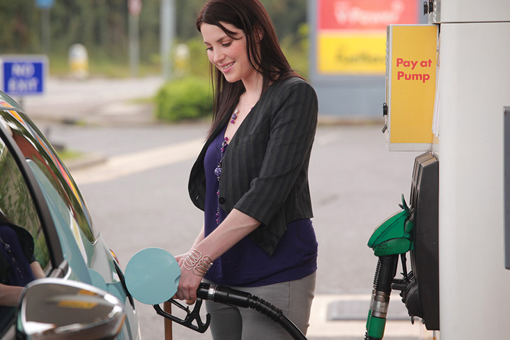 Motability Scheme customer filling up Motability Scheme car