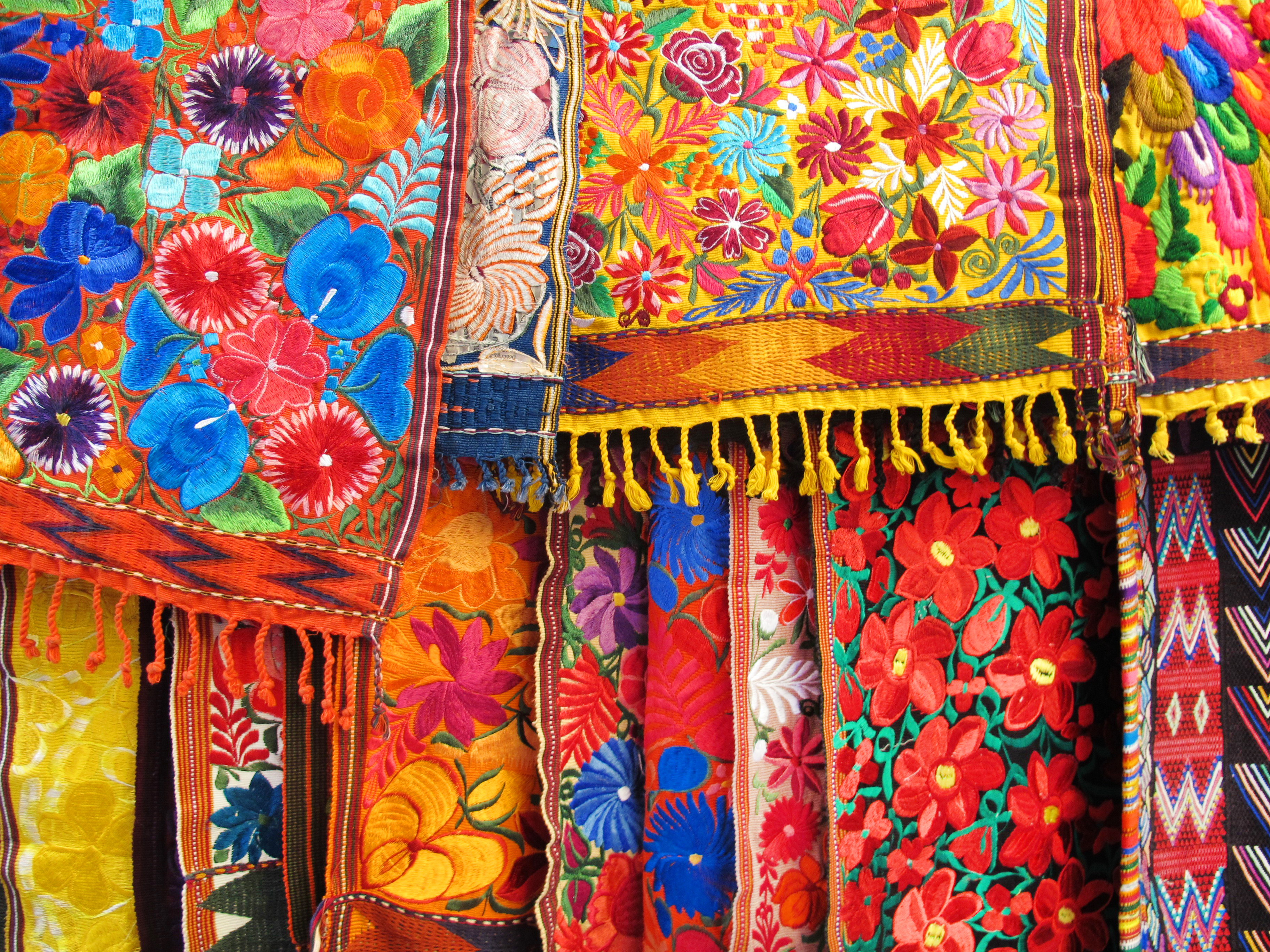 Colorful Embroidered Fabrics in an Outdoor Market in Mexico