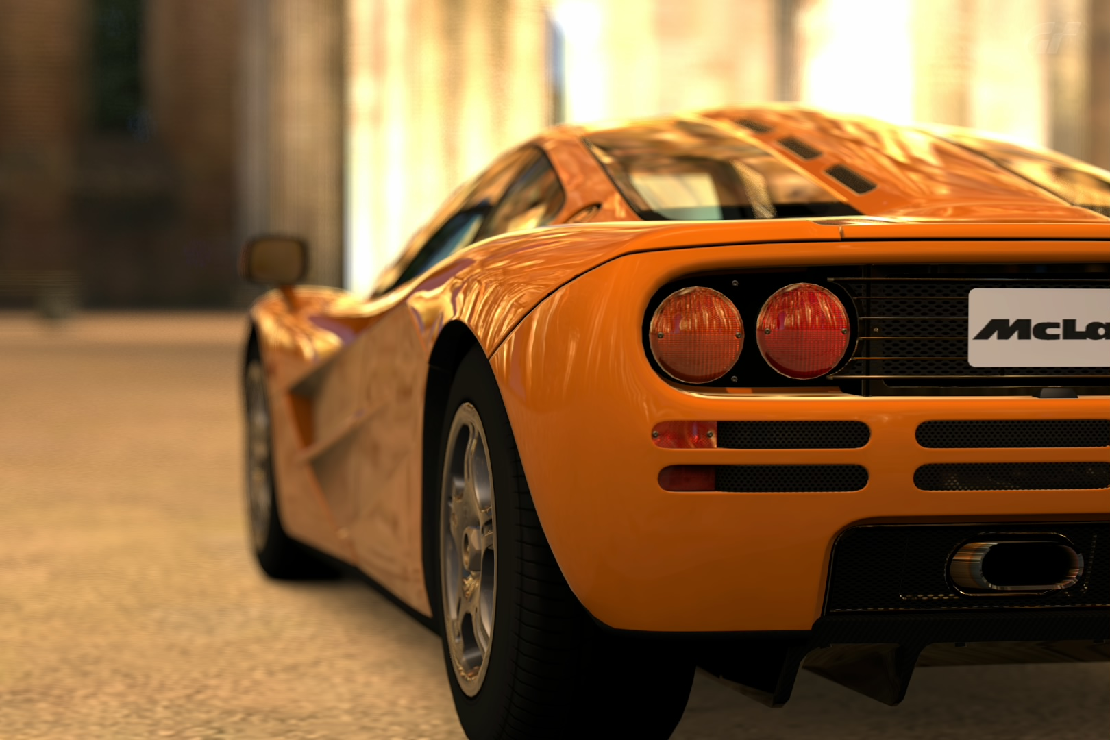 Image of the rear side of a McLaren F1 sports car