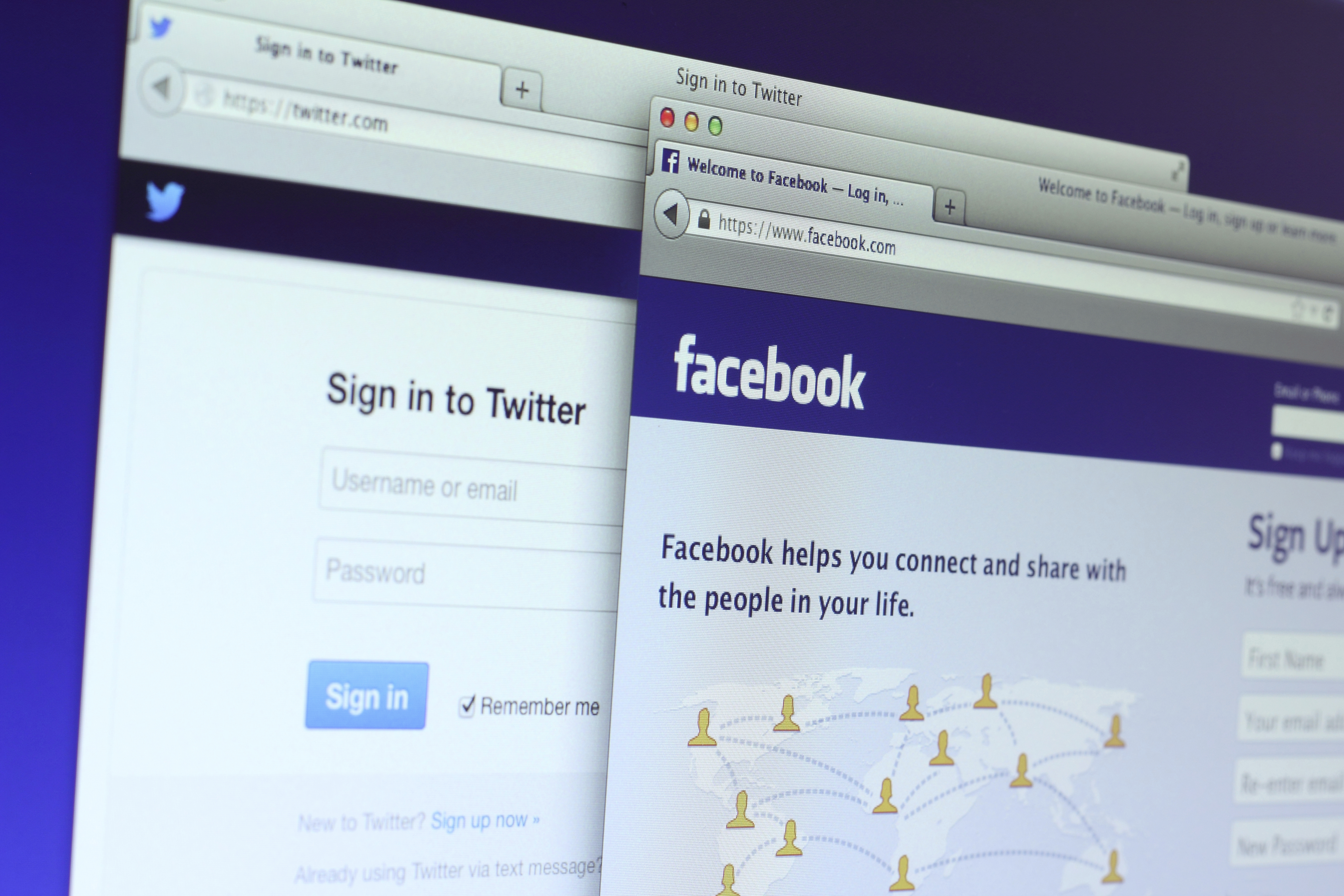 Facebook and Twitter main webpage
