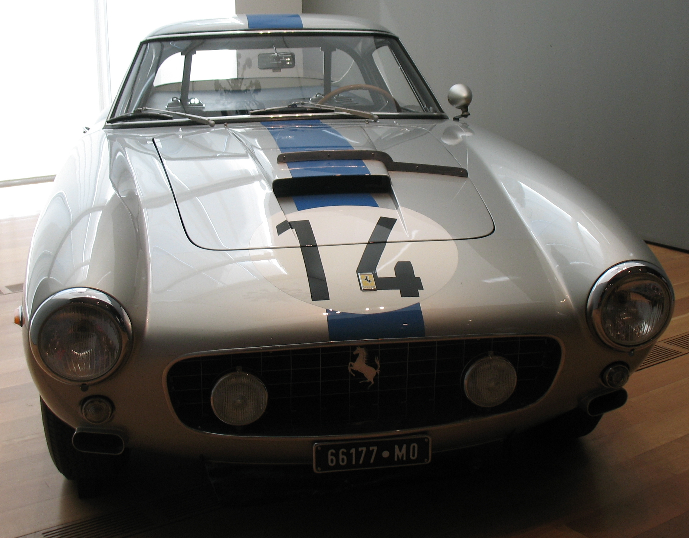Image of a silver classic car with a number 14 on the bonnet