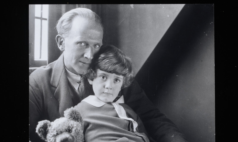 "This photo of A.A. Milne and Christopher Robin is displayed in the ""Winnie-the-Pooh"" exhibit.  (Howard Coster)"