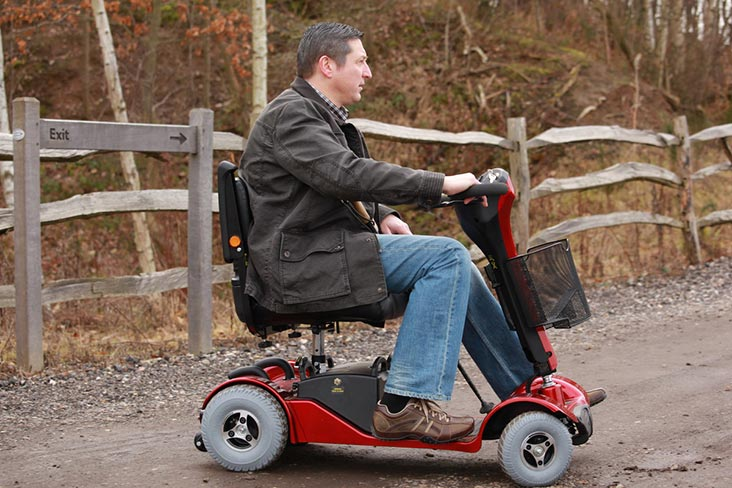 Motability Scheme customer driving scooter