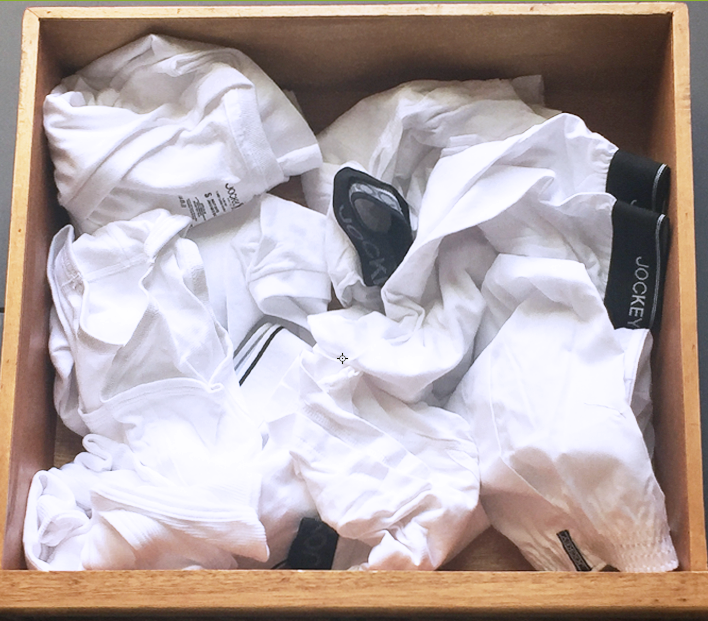 Picture of a messy, messy drawer of underwear.