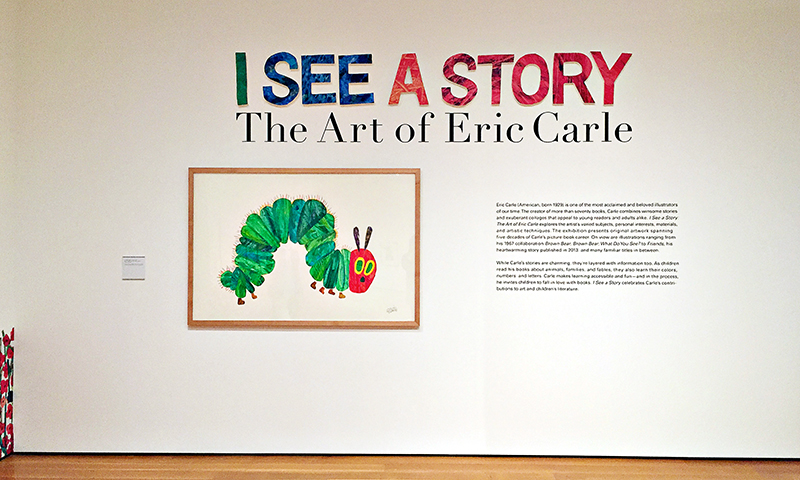 """The entrance to """"I See A Story: The Art of Eric Carle"""" features Carle's most notable character."""