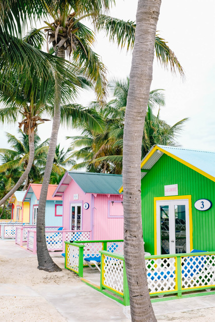 ine of colorful bungalows